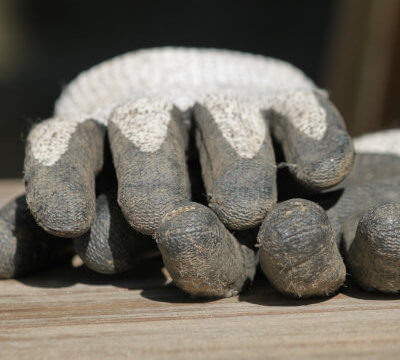 Photo of used gloves as symbol for work on house and garden
